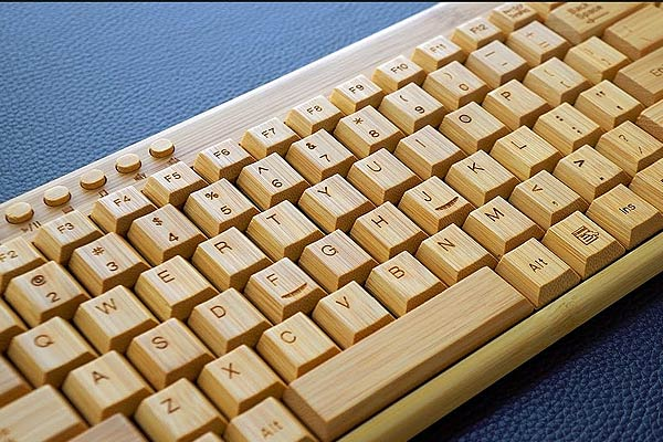 Bamboo Keyboard close up on blue table