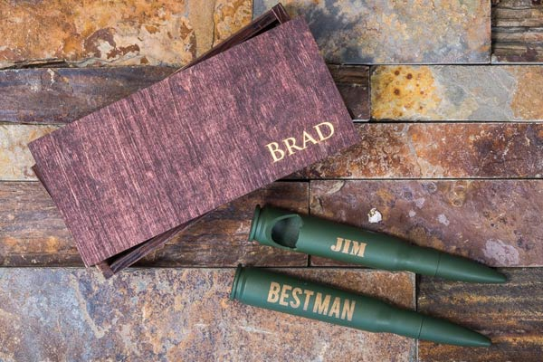 two green engraved bullet bottle opener