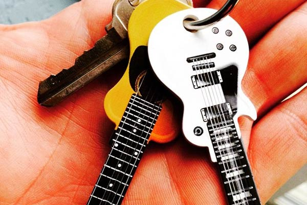 two Guitar Shaped Keys on hand
